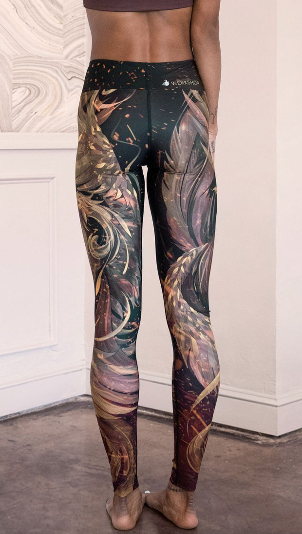 closeup front view of model wearing phoenix themed full length leggings