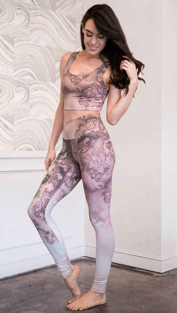 left side view of model wearing Pink/Mauve Icelandic Sheepdog Leggings with Original Tattoo-Inspired artwork