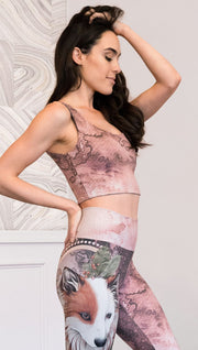 closeup right side view of model wearing watercolor artwork themed reversible sports top