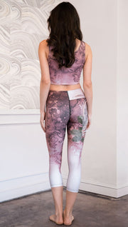 back view of model wearing pink/mauve Icelandic Sheepdog capri leggings with Original Tattoo-Inspired artwork