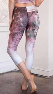 closeup back view of model wearing pink/mauve Icelandic Sheepdog capri leggings with Original Tattoo-Inspired artwork