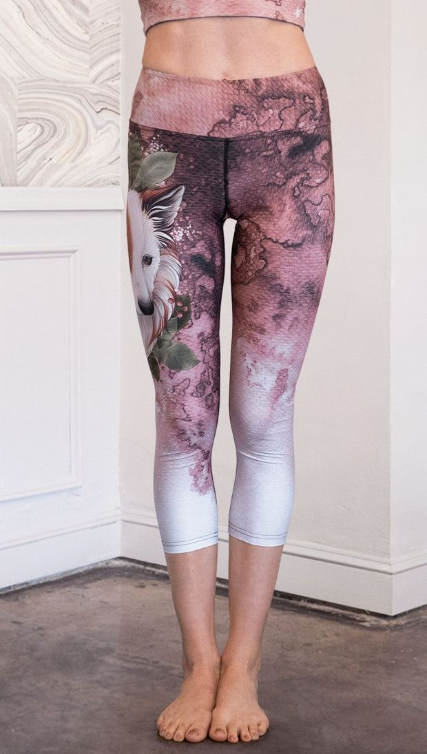 closeup front view of model wearing pink/mauve Icelandic Sheepdog capri leggings with Original Tattoo-Inspired artwork