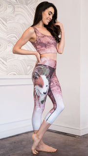 right side view of model wearing pink/mauve Icelandic Sheepdog capri leggings with Original Tattoo-Inspired artwork