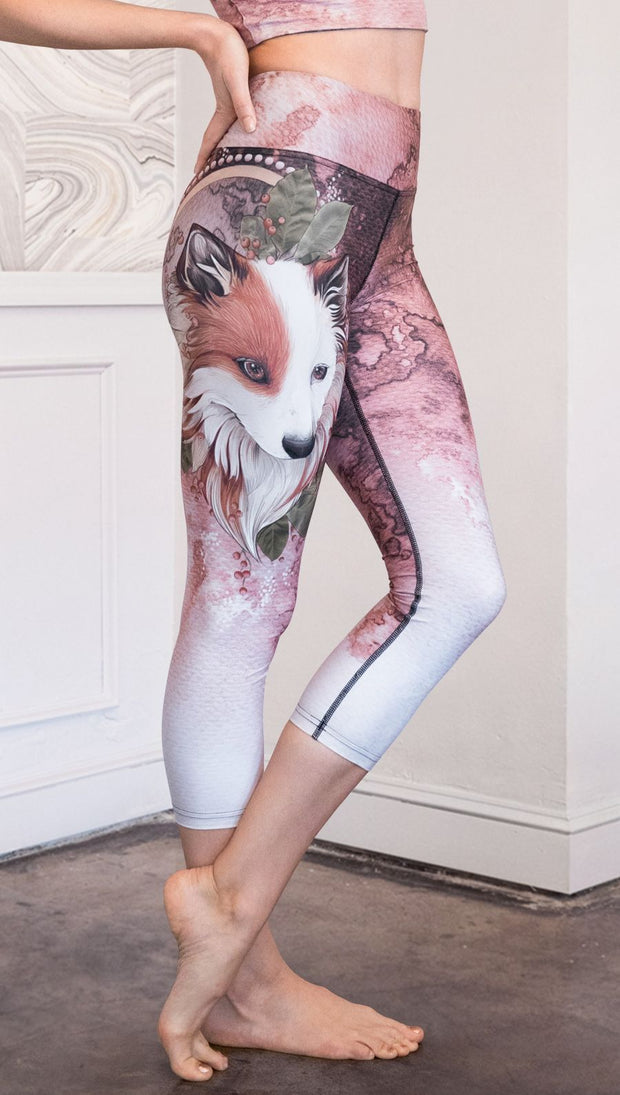closeup right side view of model wearing pink/mauve Icelandic Sheepdog capri leggings with Original Tattoo-Inspired artwork