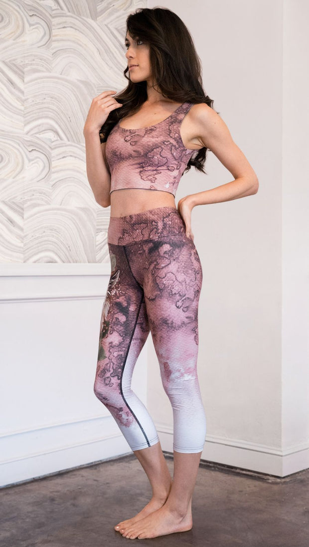 left side view of model wearing pink/mauve Icelandic Sheepdog capri leggings with Original Tattoo-Inspired artwork