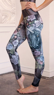 closeup side view of model wearing unicorn themed full length leggings