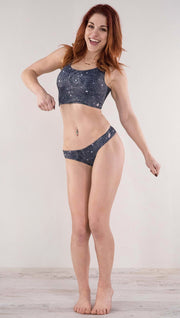 Front view of model wearing the reversible Celestial Mosaic low rise bikini bottom in the Celestial side in the color blue