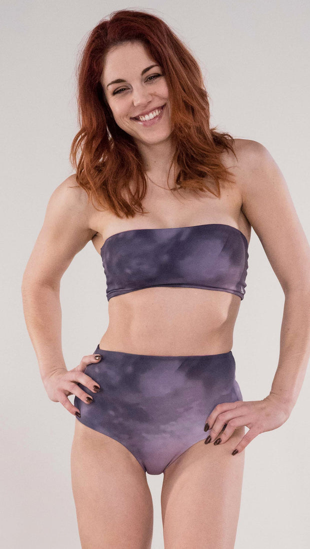 Front view of model wearing the reversible Peacock bandeau in the Peacock side in the colors purple and dark purple