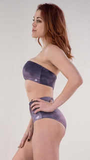 Left side view of model wearing the reversible Peacock bandeau in the Peacock side in the colors purple and dark purple