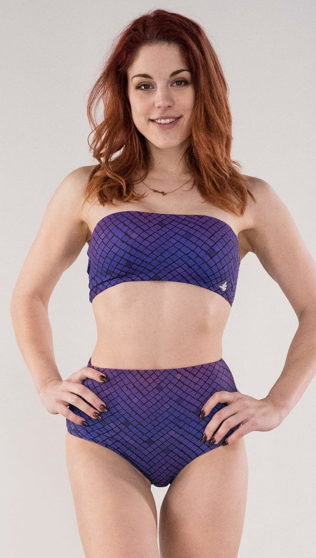 Front view of model wearing the reversible Rainbow Mosaic bandeau in the mosaic tile side in the color purple