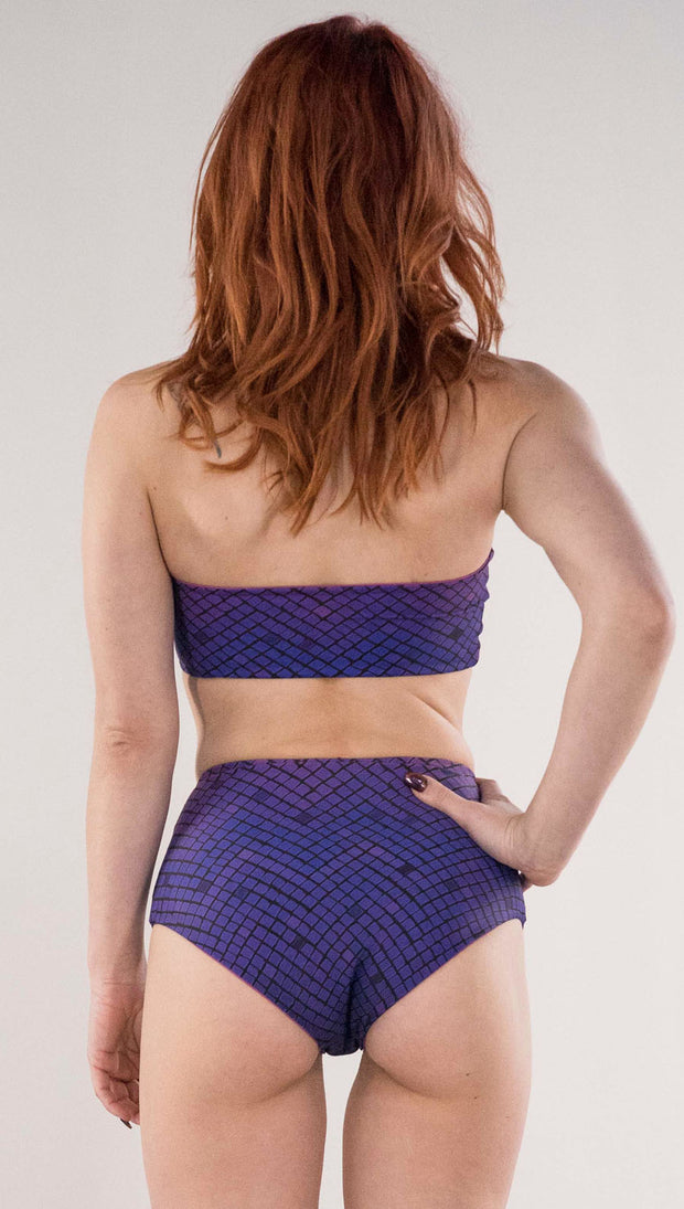 Back view of model wearing the reversible Rainbow Mosaic bandeau in the mosaic tile side in the color purple