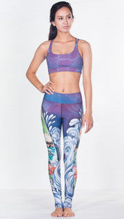 front view of model wearing surf and flower inspired printed sports bra