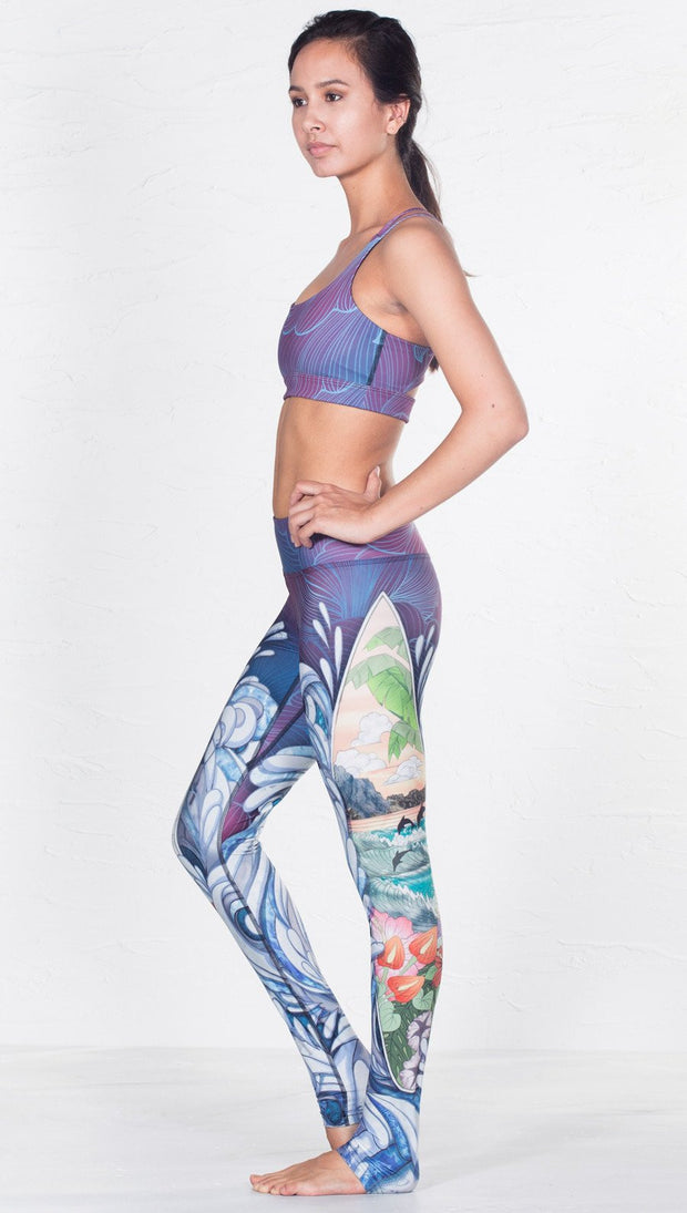 left side view of model wearing surf and flower inspired printed sports bra