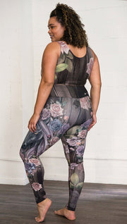 Three quarter rear left view of model wearing unicorn themed full length leggings