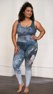 Front view of model wearing full length Finnish Lapphund artwork themed leggings