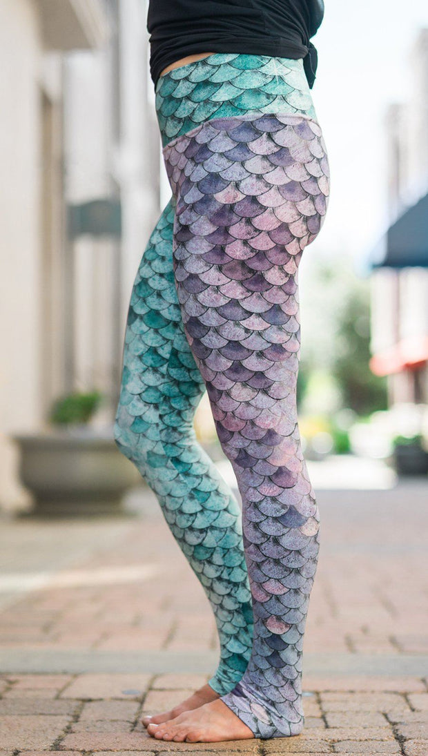 closeup left side view of model wearing mermaid scales design printed full length leggings