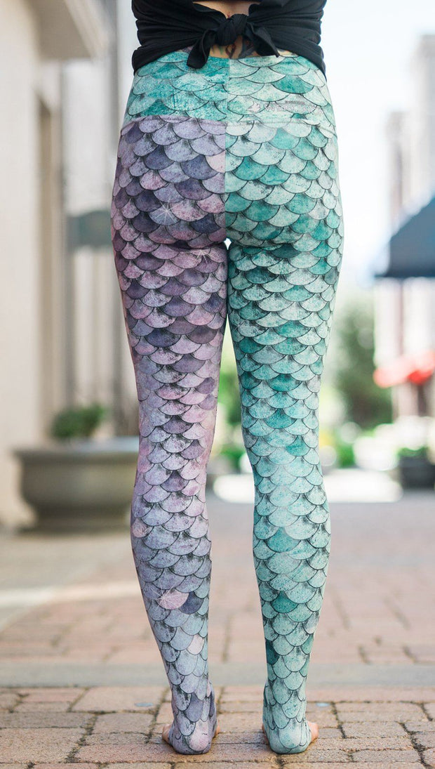 closeup back view of model wearing mermaid scales design printed full length leggings