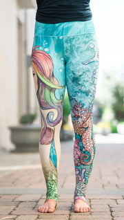 front view of model wearing under the sea mermaid and seahorse mashup printed full length leggings