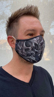 Right side view of male model wearing a black mask with a larger grey skull