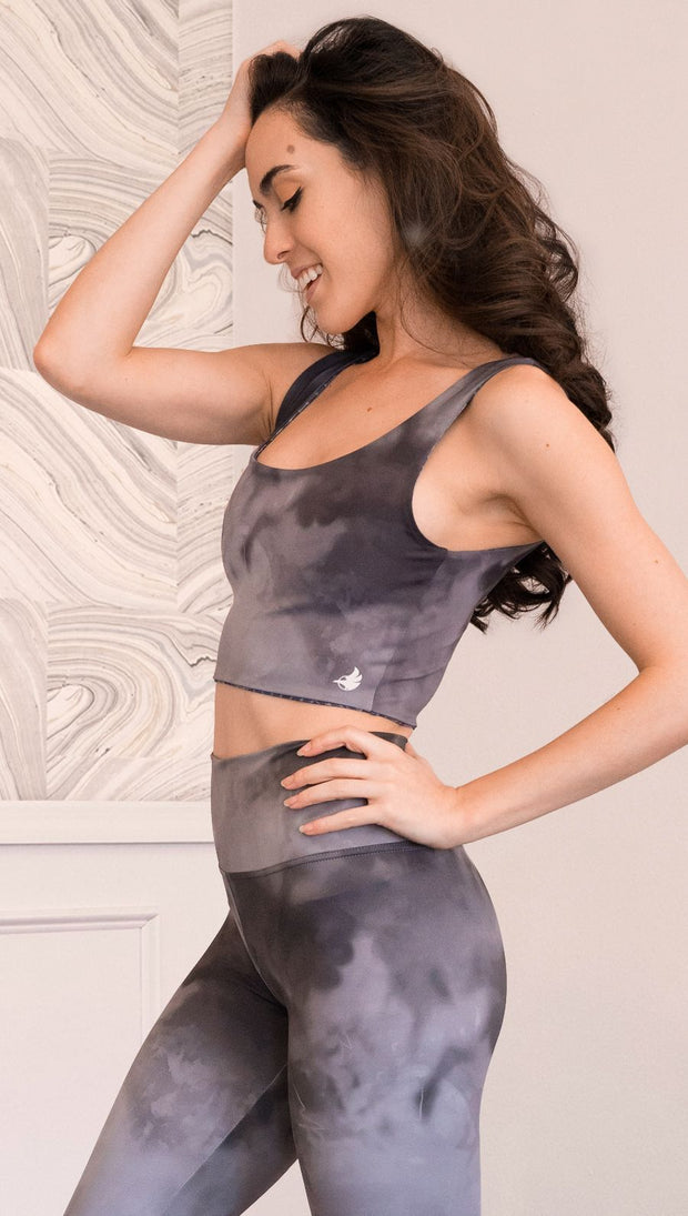 Left side view of model wearing cloudy gray ombre top
