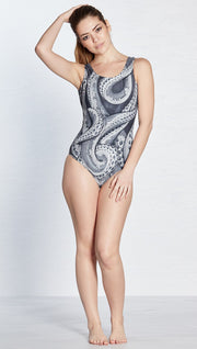 front view of model wearing black and white tentacles themed one piece swimsuit / leotard