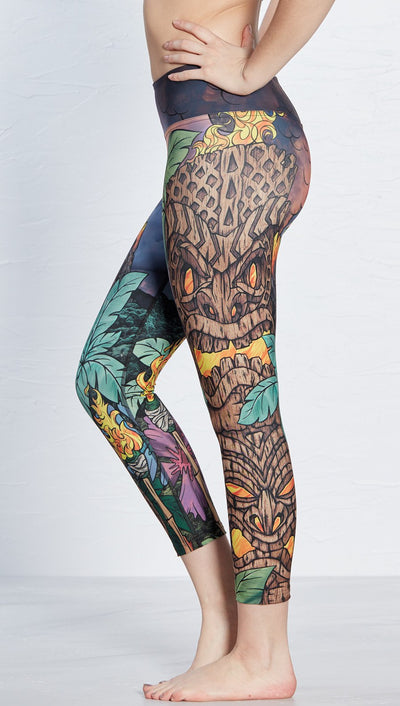 close up side view of tiki torch themed printed capri leggings
