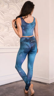 back view of model wearing full length leggings with tanzanite watercolor printed design