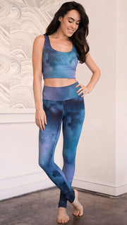 front view of model wearing full length leggings with tanzanite watercolor printed design
