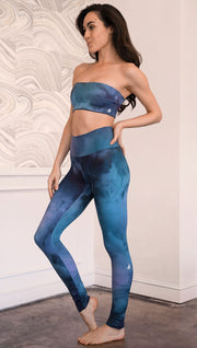 left side view of model wearing full length leggings with tanzanite watercolor printed design