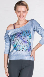 front view of model wearing graffiti design pullover