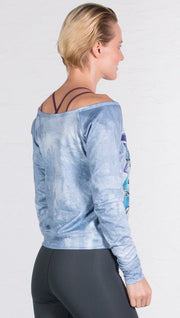 back view of model wearing graffiti design pullover