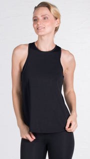 closeup front view of model wearing black tie back sports tank top
