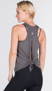 closeup back view of model wearing gray tie back sports tank top
