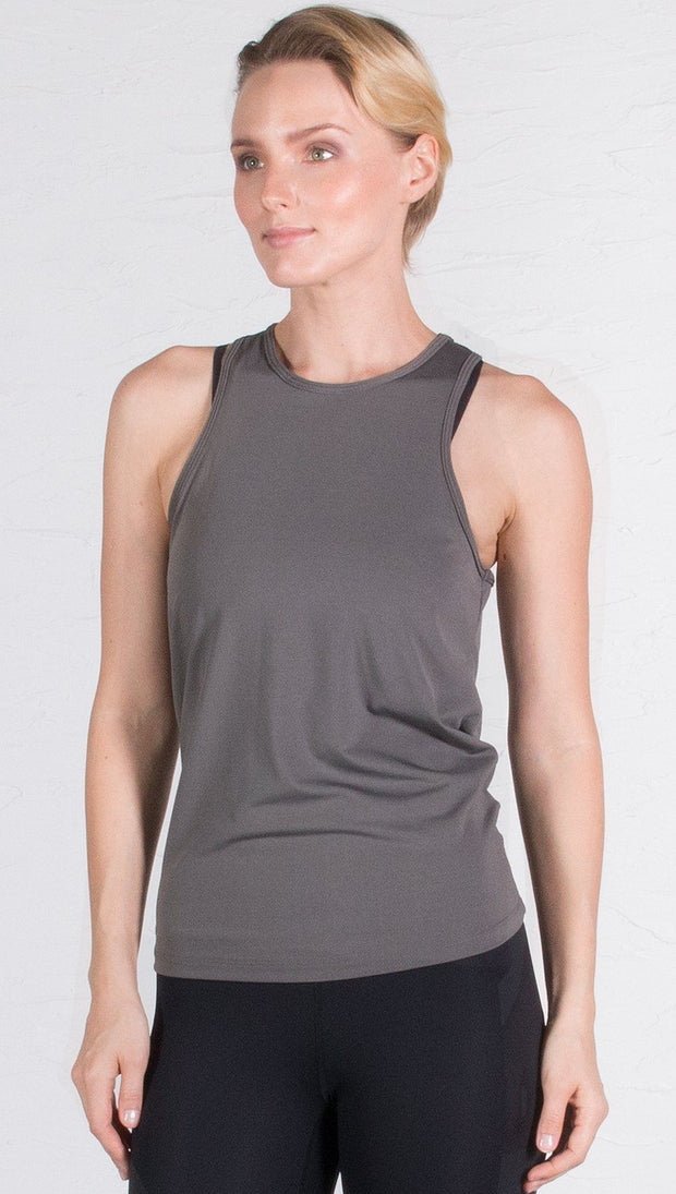 closeup front view of model wearing gray tie back sports tank top
