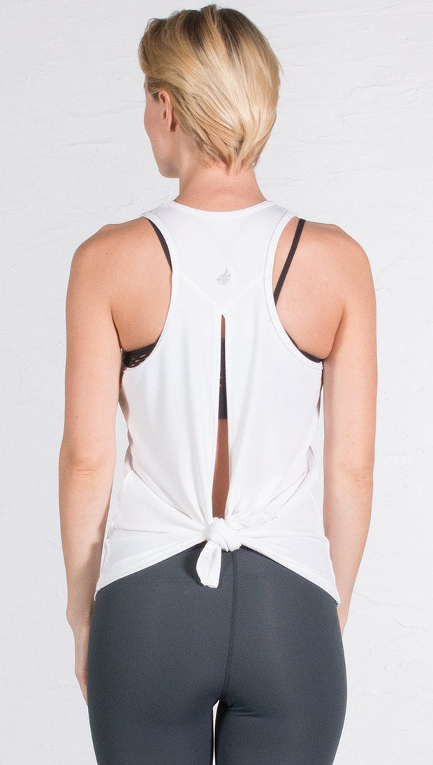 closeup back view of model wearing white tie back sports tank top