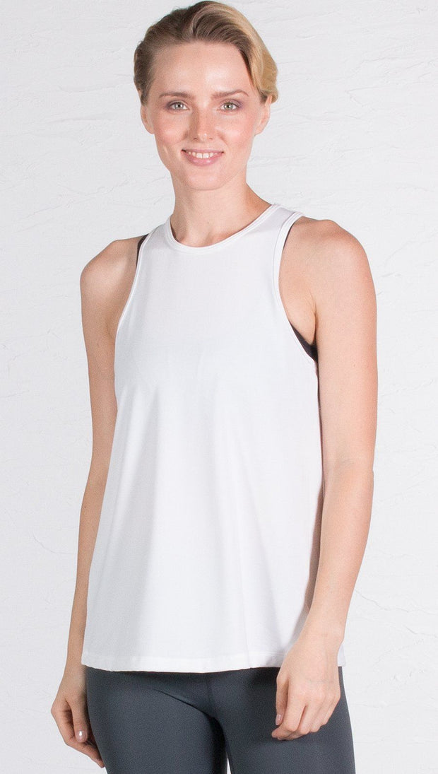 closeup front view of model wearing white tie back sports tank top