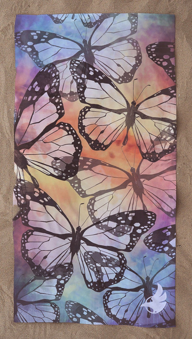 top view colorful butterfly themed beach towel
