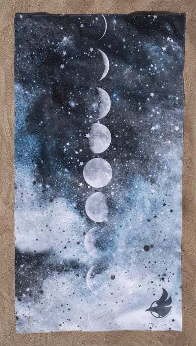 full top view of moon cycle themed beach towel