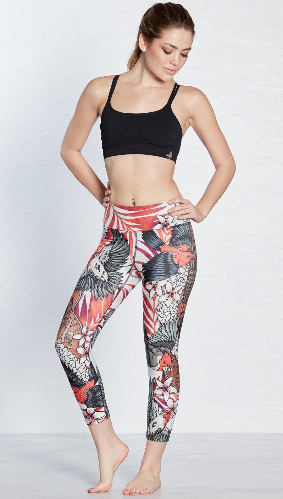 close up front view of island bird and ukulele themed printed capri leggings
