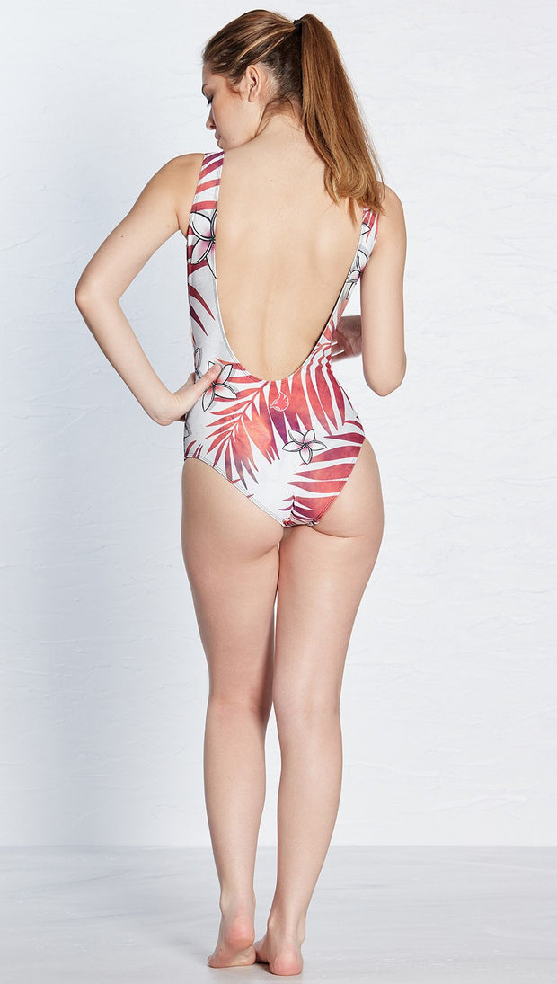 back view of model wearing tropical bird and flower themed one piece swimsuit / leotard
