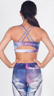 closeup back view of model wearing magical fantasy design printed sports bra