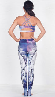 back view of model wearing magical fantasy design printed sports bra