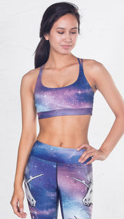 closeup front view of model wearing magical fantasy design printed sports bra