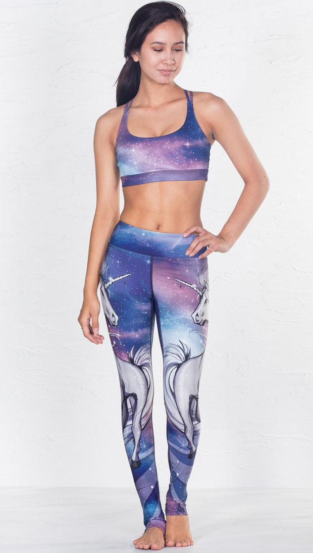 front view of model wearing magical fantasy design printed sports bra