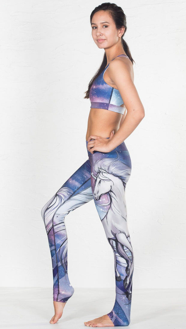 left side view of model wearing magical fantasy design printed sports bra