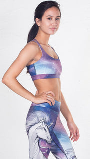 closeup right side view of model wearing magical fantasy design printed sports bra