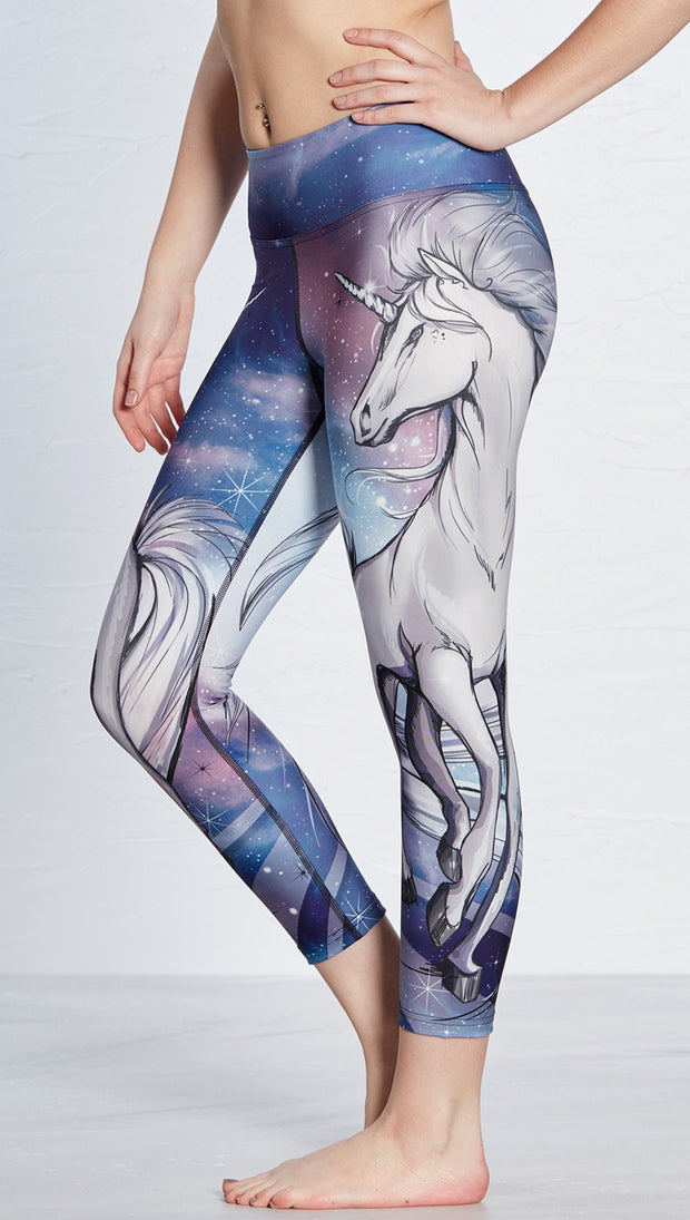 closeup left side view of model wearing unicorn design printed capri leggings
