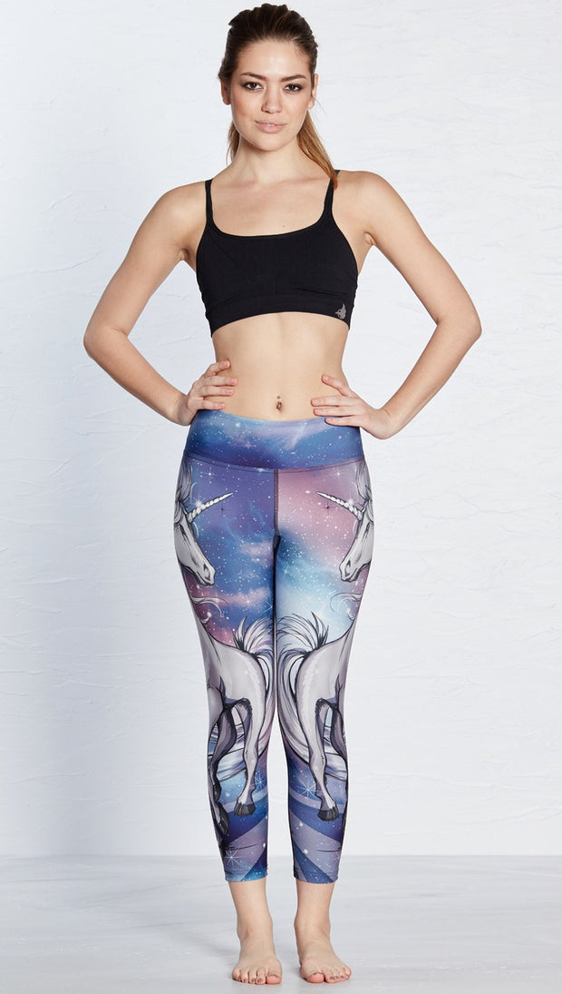 front view of model wearing unicorn design printed capri leggings
