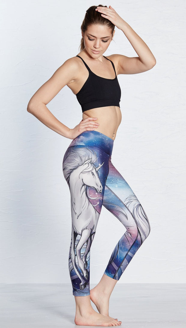right side view of model wearing unicorn design printed capri leggings