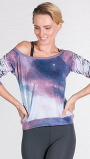 closeup front view of model wearing unicorn design printed pullover